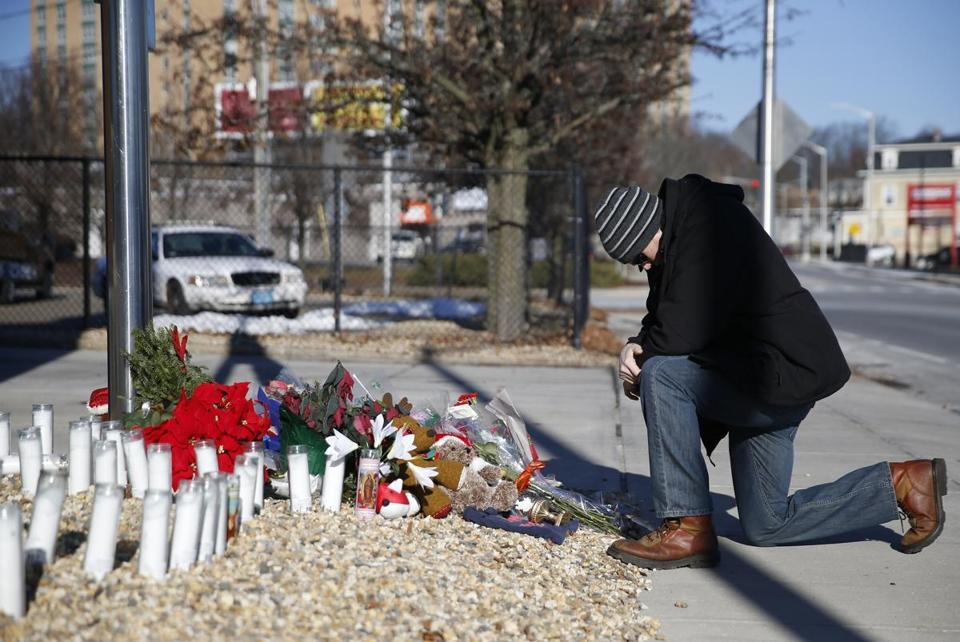Worcester, MA, 12/10/2018 -- Justin Collard of Worcester knelt to pray at a makeshift memorial in tribute to fallen firefighter Christopher J. Roy outside of his fire station. (Jessica Rinaldi/Globe Staff) Topic: 11worcesterpic Reporter: